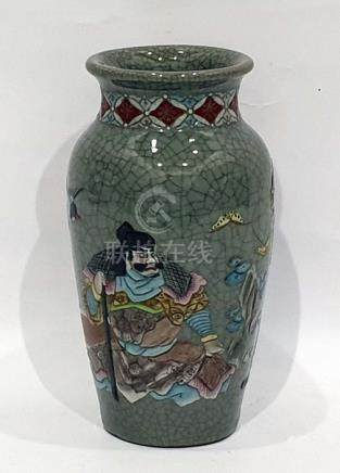 Japanese pottery crackle glazed vase with enamelled figures of warriors, ovoid and tapering, 26cm