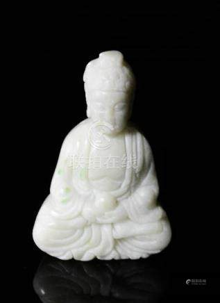 A Chinese hand carved white jade seated Buddha.