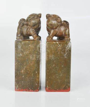 A pair of Chinese soapstone seals, carved with dogs of fo.