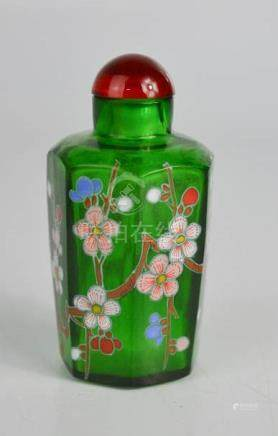 A Chinese green glass scent bottle, painted with flowers.