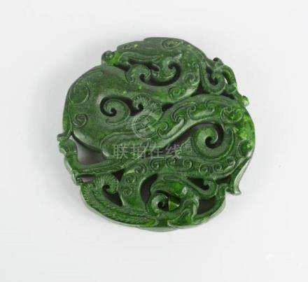 A Chinese carved Nephrite green jade dragon pendant.