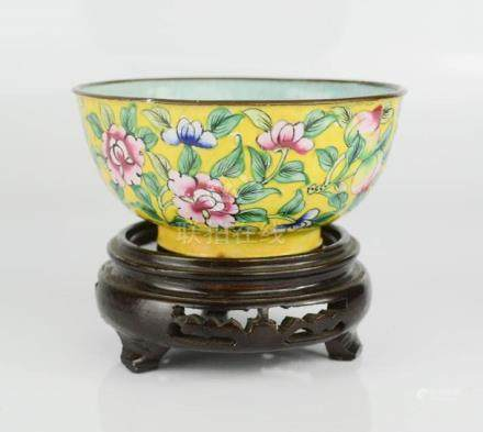 A late 19th century Chinese enamelled hand decorated Famille Rose copper bowl on laquered wooden