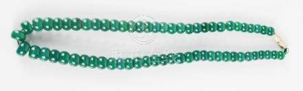 A Chinese Heitian heavy green jade bead necklace, having miau silver screw clasp.
