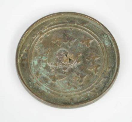 An Eastern Han Dynasty Chinese bronze mirror, 1-2nd century AD, depicting turtle and cranes.