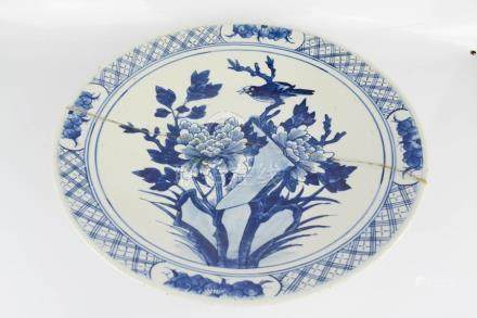 A Chinese blue and white charger, blue and white depicting a bird and flowers.