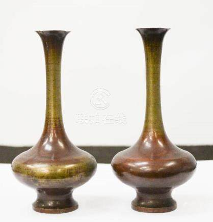 A pair of Chinese bronze vases, with residual deep red patination, 13cm high.