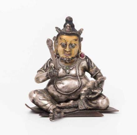 Figur des JambhalaNepal, 20.Jh. Silber und Bronze, teilweise besetzt mit Saphir und Rubin. Gesicht