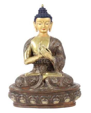 Buddha ShakyamuniTibet/Nepal, wohl um 1900, Bronze/Kupfer, part. vergoldet, in vajrasana sitzender