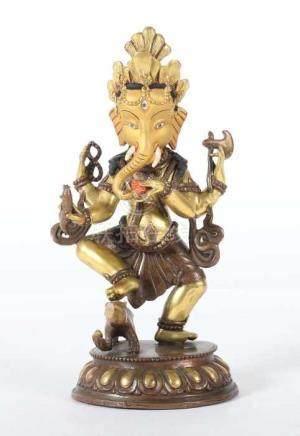 Ganesha mit seinem ReittierNepal, 20. Jh., Bronze/vergoldet, tanzender, 4-armiger Ganesha, eine