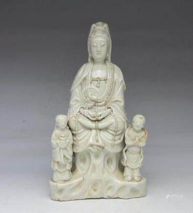 Dehua kiln Guanyin boy statue
