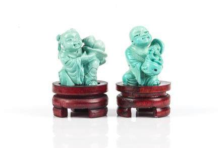 PAIR OF TURQUOISE CARVED CHILDREN FIGURES