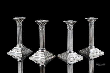 FOUR CORINTHIAN COLUMN FORM SILVER CANDLESTICKS