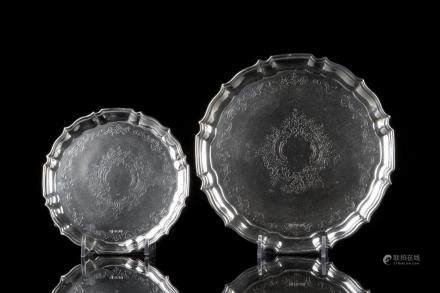 GRADUATED PAIR OF ENGLISH FOOTED SILVER SALVERS