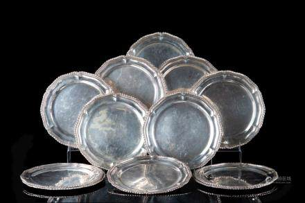 SET OF TWELVE MEXICAN SILVER CHARGER PLATES