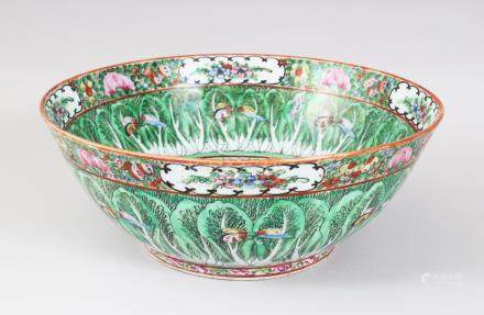 AN EARLY 20TH CENTURY CHINESE CANTON BUTTERFLY AND CABBAGE LEAF BOWL. 31cms diameter.