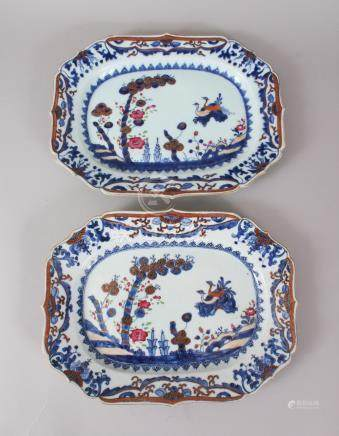A GOOD PAIR OF 18TH CENTURY CHINESE DISHES, blue and gilt ground with foliage and birds. 33cms
