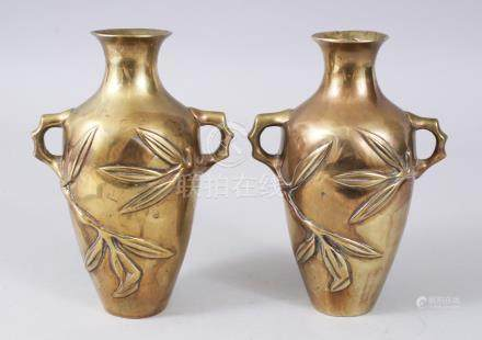 A SMALL PAIR OF 19TH CENTURY CHINESE POLISHED BRONZE VASES, with leaves in relief. 16cms high.
