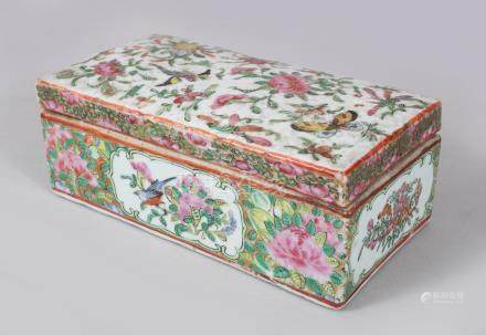 A GOOD CANTON CHINESE RECTANGULAR BOX AND COVER, painted with flowers and birds. 18cms long.