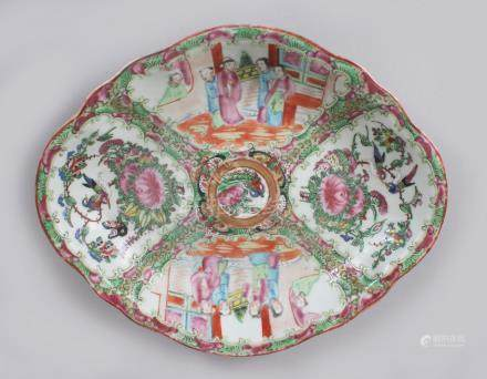 A GOOD CANTON CHINESE SHAPED OVAL DISH, painted with birds, flowers and figures. 26cms long.