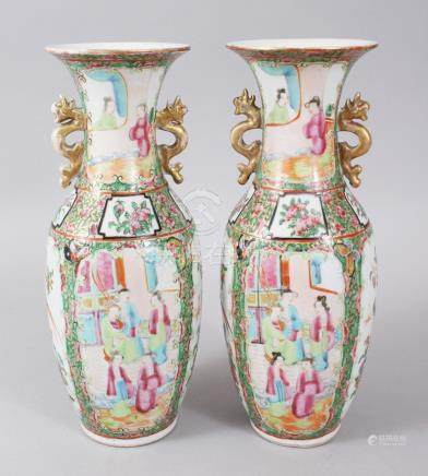 A PAIR OF CANTON CHINESE VASES, painted with four panels and vignettes of figures and birds. 26cms