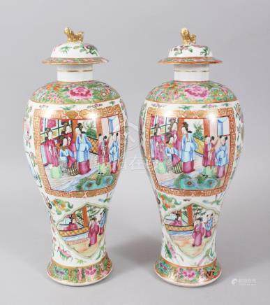 A PAIR OF CANTON CHINESE VASES AND COVERS, painted with panels of figures, birds, flowers and