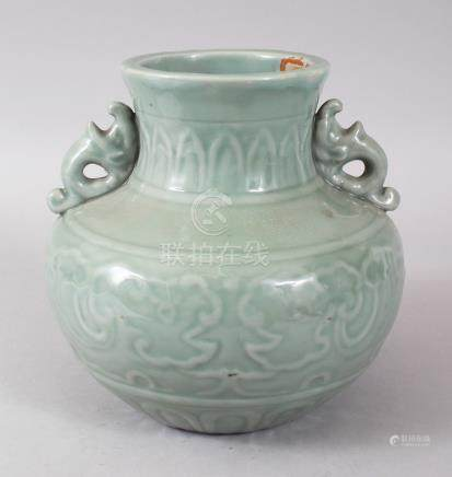 A MING STYLE CELADON TWO-HANDLED VASE, with mounted panels. 20cms high.