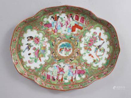 A GOOD CANTON CHINESE SHAPED OVAL DISH, painted with panels of birds, flowers, butterflies and