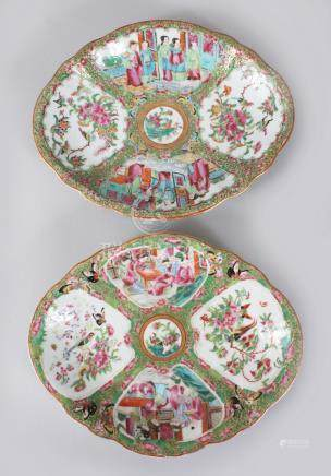 A GOOD PAIR CANTON CHINESE SHAPED OVAL DISHES, painted with panels of birds, flowers, butterflies