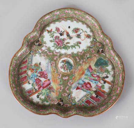A GOOD CANTON CHINESE CIRCULAR CLOVERLEAF SHAPED DISH, painted with three panels of figures,