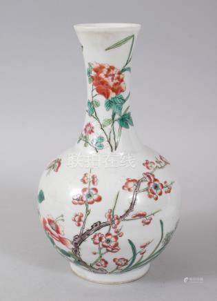 A CHINESE FAMILLE ROSE MOTTLED VASE, with flowers. 22cms high. Six character mark.