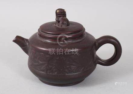 A CHINESE YIXING TERRACOTTA POTTERY TEAPOT AND COVER, with kylin handle.