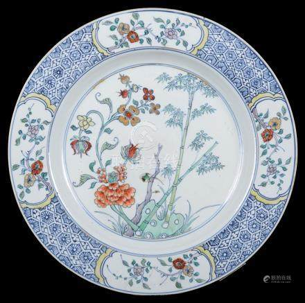 A Chinese doucai plate 18th century Finely decorated with flowering branch and bamboo;