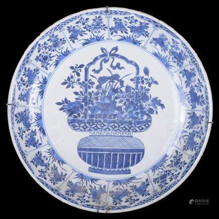 A Chinese blue and white charger 18th century Finely decorated with a basket of peonies and a band