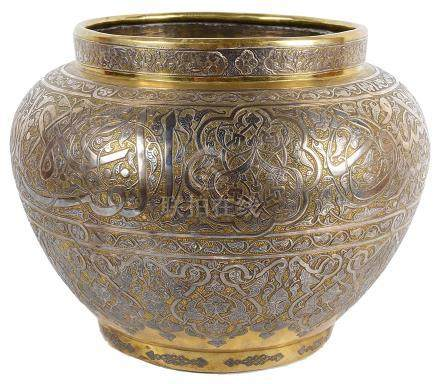 A Persian brass and silver bowl 18th/19th century Elegantly decorated with Arabic calligraphy and