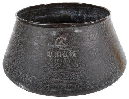 A Middle-Eastern brass bowl 19th century In Mamluk style and decorated with Arabic calligraphy,