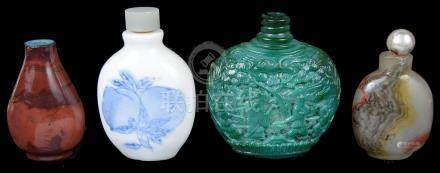 Four Chinese snuff bottles 19th century To include: a blue and white snuff bottle decorated with a