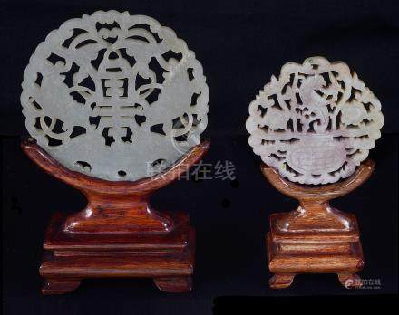 Two Chinese jade round plaques 19th century Carved in openwork as a basket of flowers and dragon