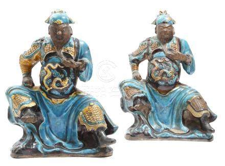 Two similar Chinese figures of Guandi, with turquoise, aubergine and yellow glazes, he sits on