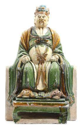 A Chinese pottery tile maker's figure of the immortal Tudi, with sancai glaze, the seated