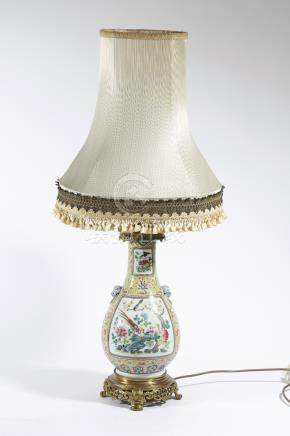 A Chinese porcelain pear shaped vase table lamp, decorated in the famille rose palette with panels