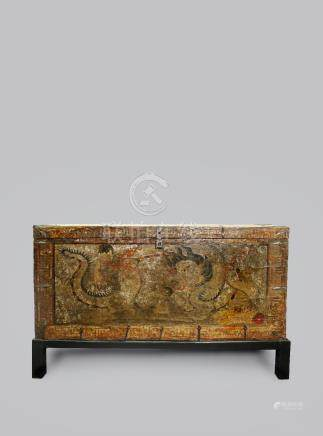 A Tibetan lacquered wood 'Dragon 'Chest', partially covered with canvas and with metal mounts, on