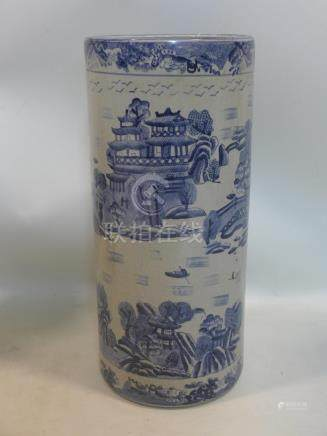 An early 20th century Chinese porcelain stick stand, hand-painted in blue and white with oriental
