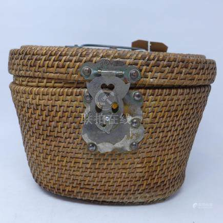 A 20th century Chinese porcelain tea pot in wicker carry case