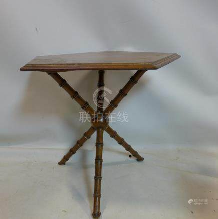 A Howard & Sons gypsy table with carved faux bamboo legs, H.65 W.71 D.70cm