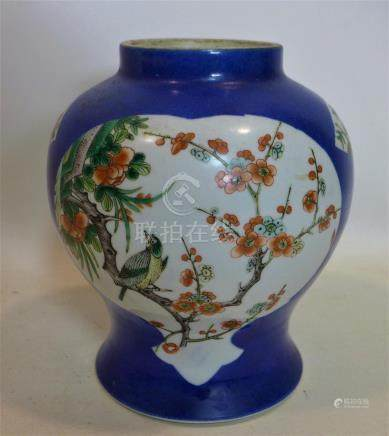 A 19th century Chinese porcelain vase, with flora and fauna panels, on a blue ground, with