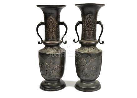 A pair of Chinese bronzed twin-handled vases, each with relief bird decoration to bodies, 33.5 cm