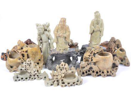 Seven Chinese carved soapstone brush pots, decorated with flowers, foliage and monkeys, together
