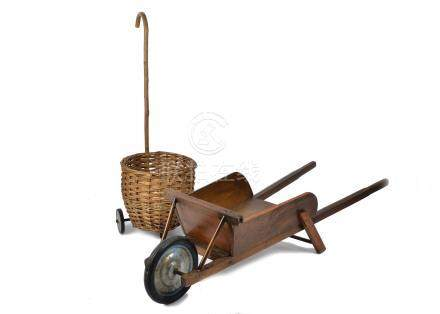 A vintage child's wicker shopping basket on wheels, together with a child's wooden wheelbarrow (2)