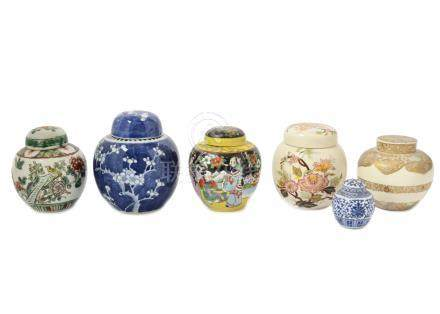 A collection of Chinese and Japanese ginger jars, including Famille Verte, blue and white and
