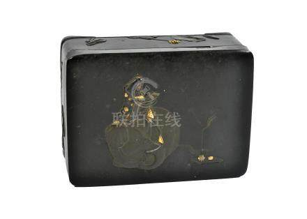 A Japanese takamaki-e decorated metal box, with scholar sitting on an elephant to lid, foliate